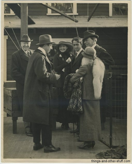Press photo picturing, from left to right: Sir Herbert Beerbohm Tree, D.W. Griffith, Hedda Hopper, John Emerson, De Wolf Hopper and with her back to the camera, Anita Loos