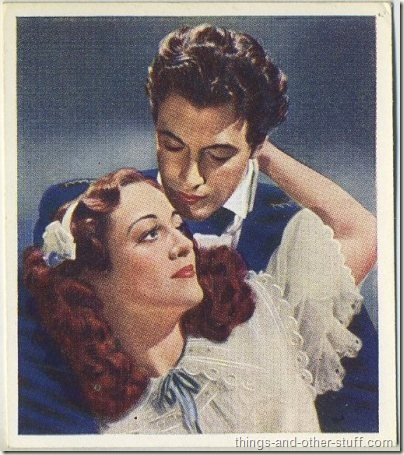 1939 Godfrey Phillips Famous Love Scenes tobacco card features Taylor with Joan Crawford in The Gorgeous Hussy