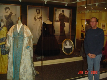 Charles Triplett stand in front of one of the displays at the Ava Gardner Museum.