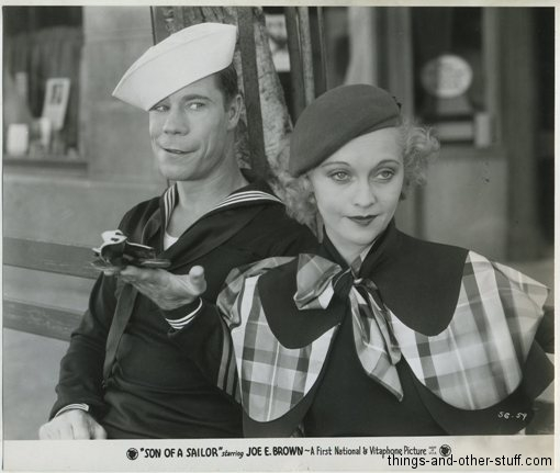 Joe E. Brown and Jean Muir pictured in Son of a Sailor (1933) on a vintage movie still photo