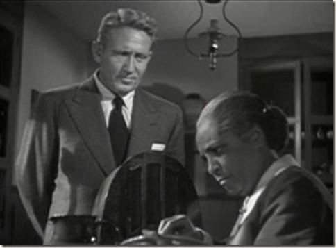 Spencer Tracy and Jessie Grayson listen to The Green Dragon in Cass Timberlane
