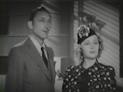 Warren William and Joan Blondell