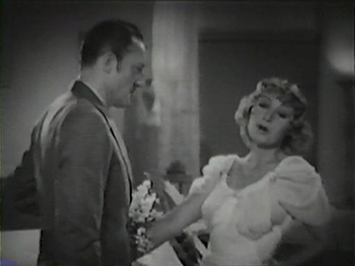 Warren William with Joan Blondell
