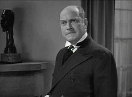 Eric Blore as Bayliss the Butler