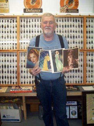 Joe Cook holding 4 Auto Lite Spark Plug movie premiums