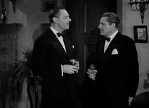 Jerome Cowan and Warner Baxter