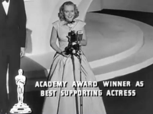 Celeste Holm collects her Oscar
