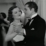 Myrna Loy and Warner Baxter