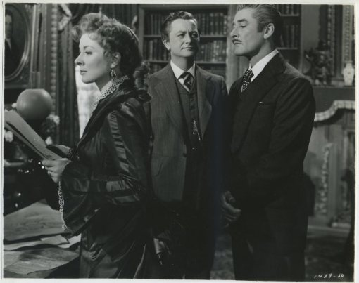 Greer Garson with Robert Young and Errol Flynn
