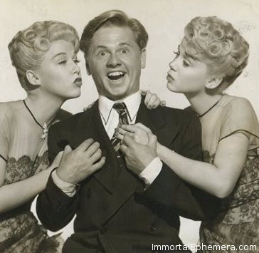 Mickey Rooney surrounded by Lee and Lyn Wilde on a 1945 Press Photo