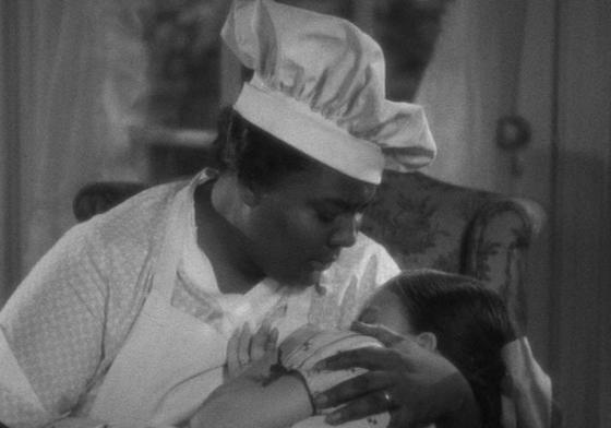Louise Beavers comforts young Peola in Imitation of Life