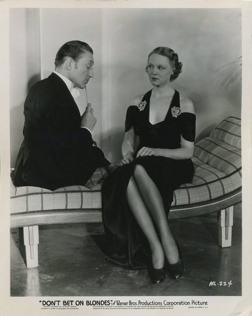 Warren William and Claire Dodd publicity still