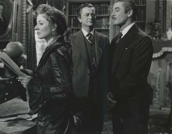 Greer Garson Robert Young and Errol Flynn