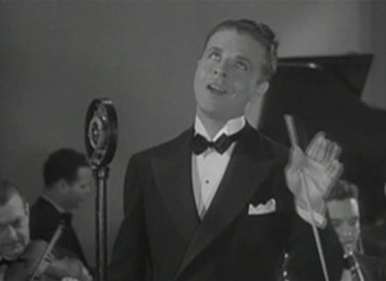 Dick Powell in Blessed Event