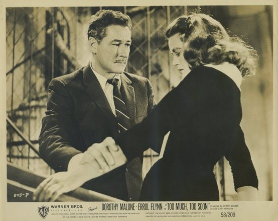 Errol Flynn and Dorothy Malone