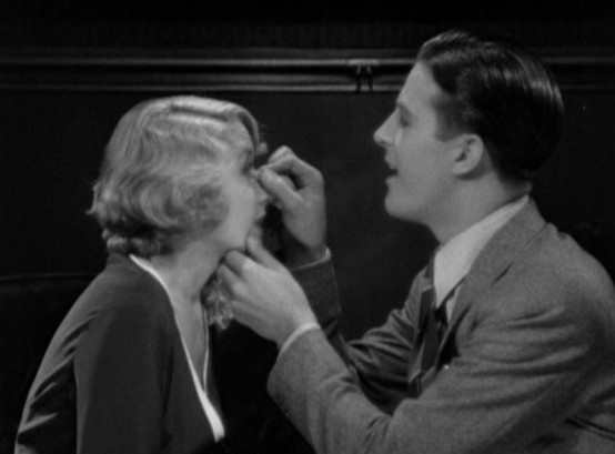 Joan Blondell and Ray Milland