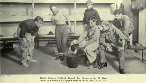 Above: Hohl is seated holding something over the bucket in this photo from In the Zone published in Theater Magazine, December 1917. (Click to enlarge).