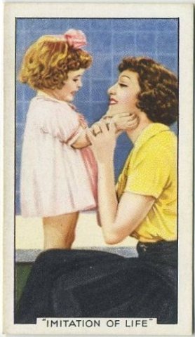 Juanita Quigley billed as Baby Jane in Imitation of Life (1934) with Claudette Colbert.